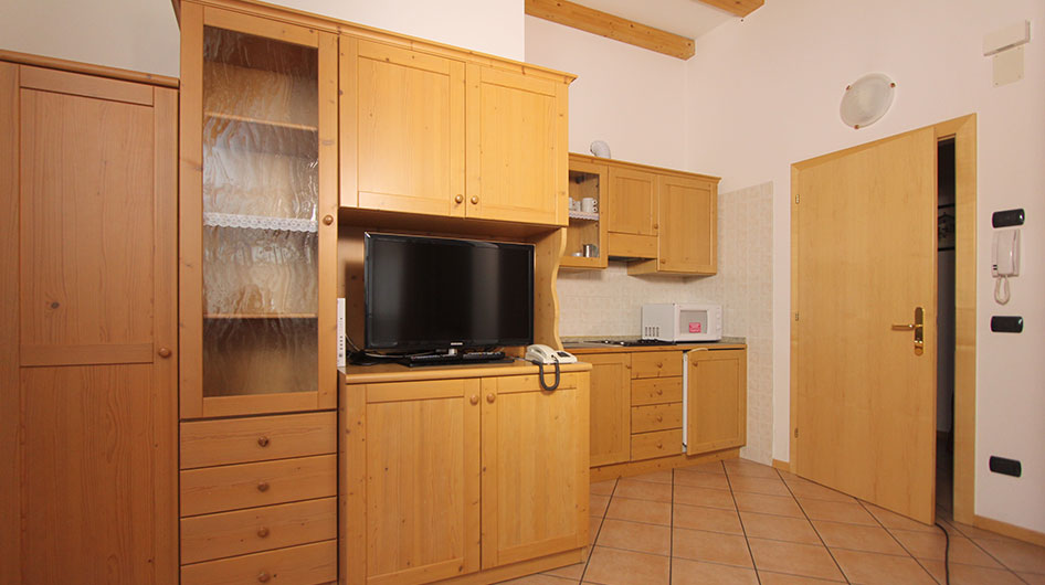 Kitchen and living room of the apartment of Hotel Ambiez