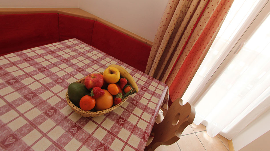Basket of fruits on the dining table