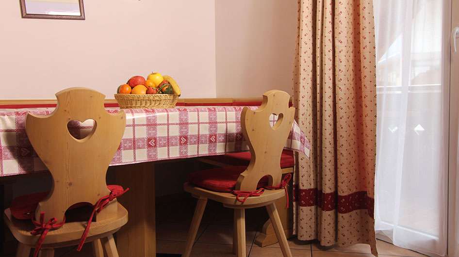 Wooden table with decorative red details