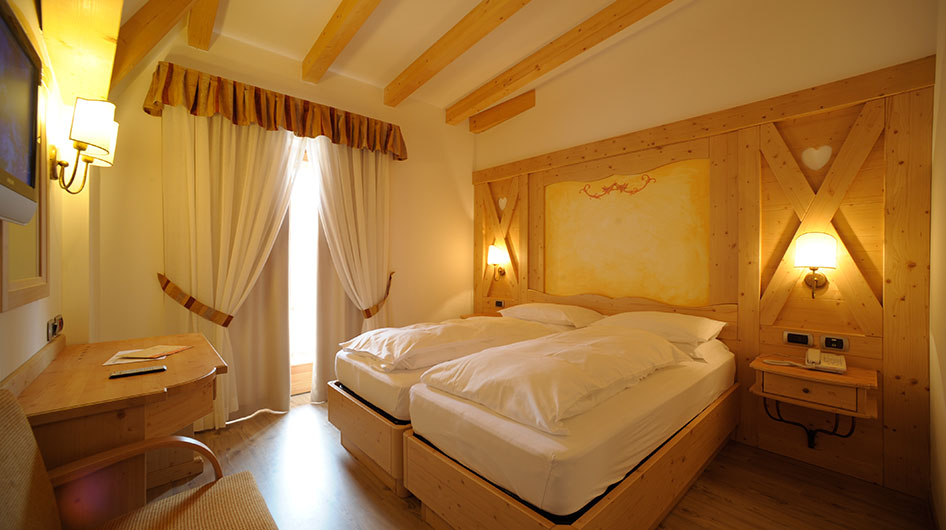 Double bed with wooden wall headboard
