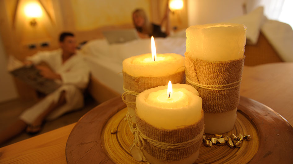 Ambiez Hotel guests relax in a room with lit candles