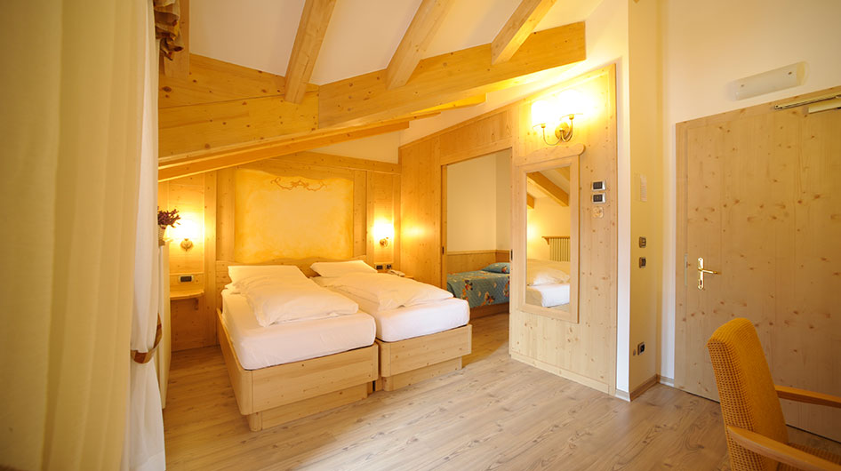 Family room of Hotel Ambiez with alpine atmosphere and wooden furniture