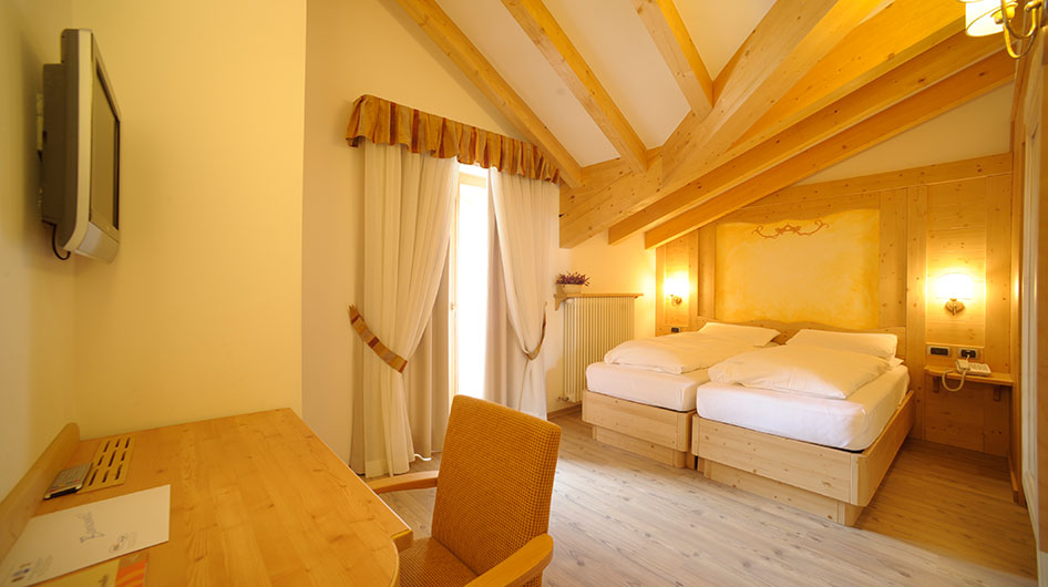 Room in the attic with a double bed