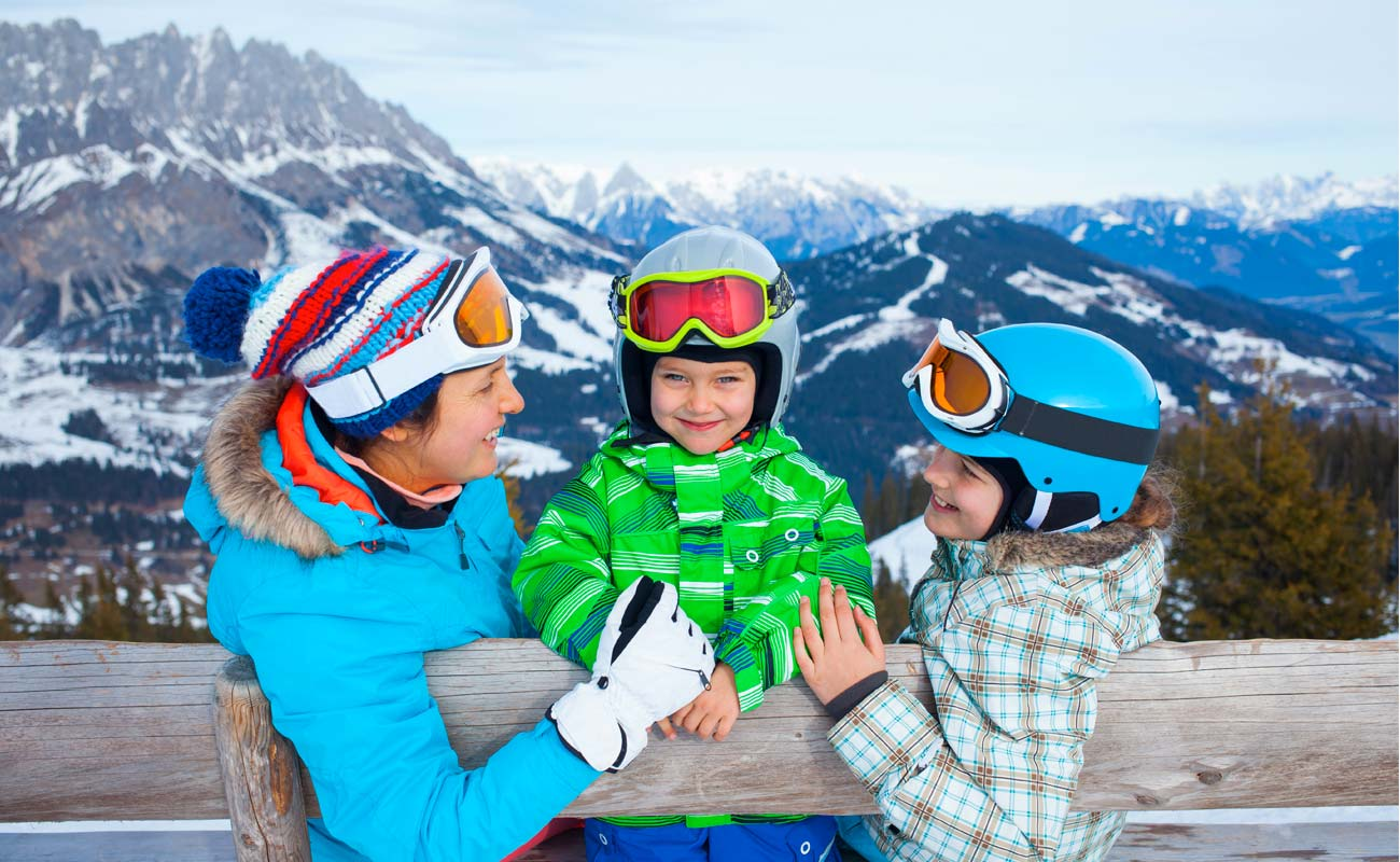 Children with a parent during a day on the snow