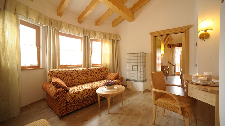 Suite of Hotel Ambiez in Andalo with sofa and table