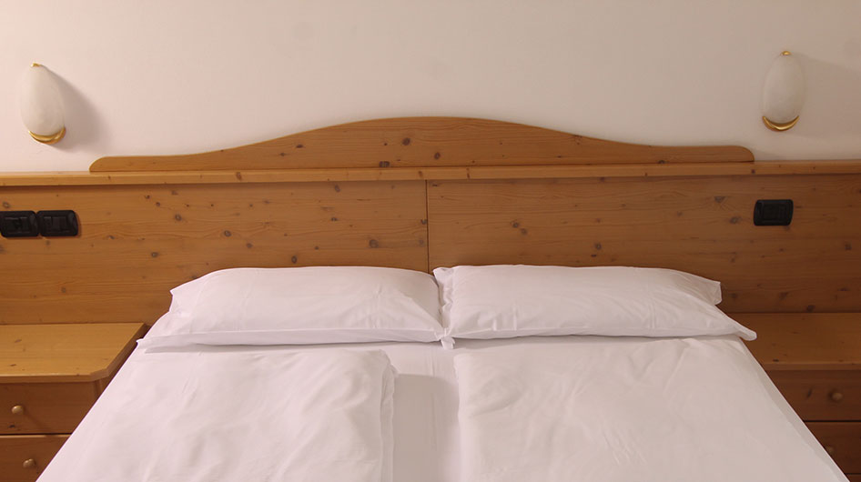 Double bed with wooden headboard